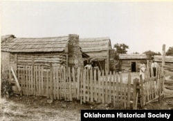 FILE - A Freedmen cabin is pictured in Okmulgee, Indian Territory, c. 1898-1901. (Courtesy - Oklahoma Historical Society)