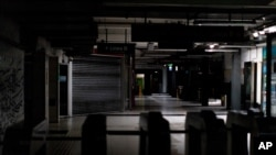Hallways of Buenos Aires' subway are lit only by emergency lights during a blackout, in Buenos Aires, Argentina, June 16, 2019.