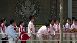 In this May 2012 file photo, Chinese students wait outside the U.S. Embassy for their visa application interviews in Beijing, China. The Open Doors report says the number of international students in the U.S. has increased from 764,000 in 2011 to more than 1 million in 2020.