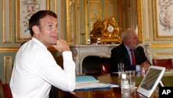 French President Emmanuel Macron during a videoconference on the conoravirus with Group of Seven leaders at the Elysee Palace in Paris, Thursday, April 16, 2020.