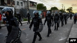 Riot police walk the streets after a demonstration against the government of President Miguel Diaz-Canel in Arroyo Naranjo Municipality, Havana, July 12, 2021.