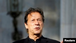 FILE - Pakistan's Prime Minister Imran Khan speaks during a joint news conference with Afghan President Ashraf Ghani (not pictured) at the presidential palace in Kabul, Afghanistan, Nov. 19, 2020.