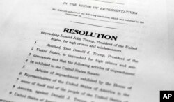 ,A copy of a page of the Articles of Impeachment is seen in Washington, Dec. 10, 2019.