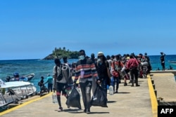 Stranded migrants from Cuba, Haiti and Africa arrive in Capurgana near the border with Panama, Colombia, July 31, 2021.