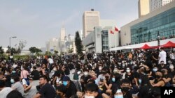 Students and others gather during a demonstration at Edinburgh Place in Hong Kong, Aug. 22, 2019. High school students thronged a square in downtown Hong Kong Thursday to debate political reforms as residents gird for further anti-government protests.