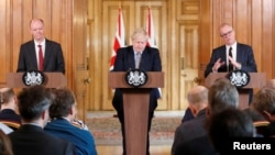 Britain's Prime Minister Boris Johnson, Chris Whitty, Chief Medical Officer for England and Chief Scientific Adviser to the Government, Sir Patrick Vallance, attend a news conference on the novel coronavirus, in London, March 3, 2020.