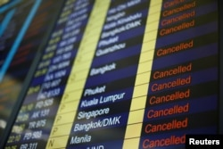 The departure board shows all flights leaving Hong Kong canceled, Aug. 12, 2019.