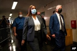 Letitia James, attorney general of New York, and Cyrus Vance Jr., New York County district attorney, leave Manhattan criminal court, July 1, 2021, in New York.