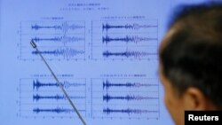 Japan Meteorological Agency's earthquake and tsunami observations division director Toshiyuki Matsumori points at graphs of ground motion waveform data observed in Japan during a news conference in Tokyo, Japan, September 3, 2017.
