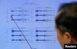 Japan Meteorological Agency's earthquake and tsunami observations division director Toshiyuki Matsumori points at graphs of ground motion waveform data observed in Japan during a news conference at the Japan Meteorological Agency in Tokyo, Japan, Sept. 3, 2017.