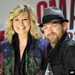 Jennifer Nettles, left, and Kristian Bush from the band Sugarland pose backstage with the award for vocal duo of the year at the 45th Annual CMA Awards in Nashville, Tenn., Nov. 9, 2011.