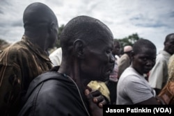 FILE - Moses Sokiri, whose son, Duku Evans, was killed Nov. 3 amid fighting between government troops and rebels in the Logo displaced persons camp in Kajo Keji, South Sudan, weeps at his son's funeral on the Ugandan border, Nov. 5, 2017.