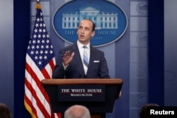 FILE - White House senior policy adviser Stephen Miller discusses U.S. immigration policy at the daily press briefing at the White House in Washington, Aug. 2, 2017.