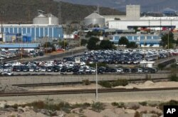 FILE - Cars sit at the General Motors plant in Ramos Arizpe, Mexico, Nov. 21, 2013.