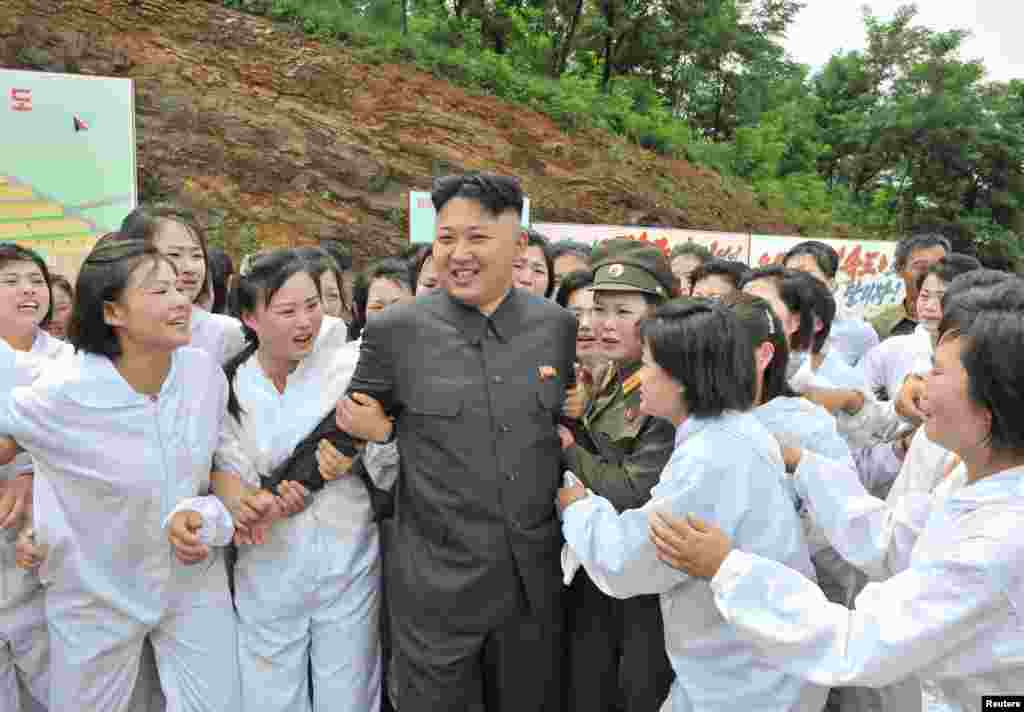 North Korean leader Kim Jong-un visits a mushroom farm in this undated photo released by North Korea's Korean Central News Agency (KCNA) in Pyongyang.