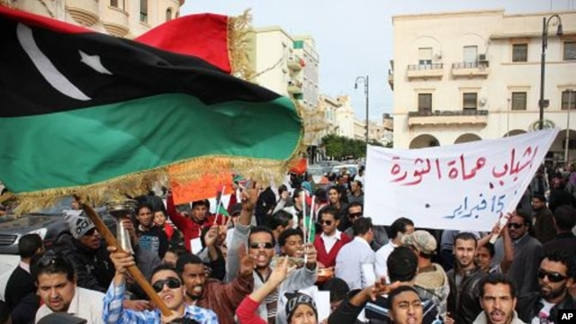 Men chant slogans during a protest in Benghazi, Libya, December 12, 2011.