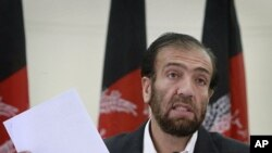 Afghan Election Commission Chairman Fazel Ahmad Manawi reads off names of the new parliamentarians during a press conference in Kabul, Afghanistan, August 21, 2011