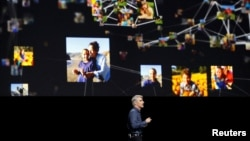 Craig Federighi, Senior Vice President of Software Engineering for Apple Inc., talks about photos within iOS at the company's World Wide Developers Conference in San Francisco, California, U.S. on June 13, 2016.