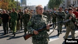 Pro-Russian Separatists March Ukrainian POWs Through Donetsk