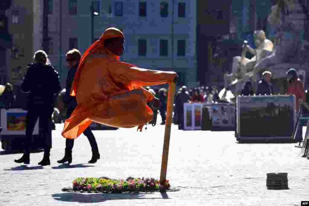 A street artist performs in Piazza Navona in Rome, Italy.