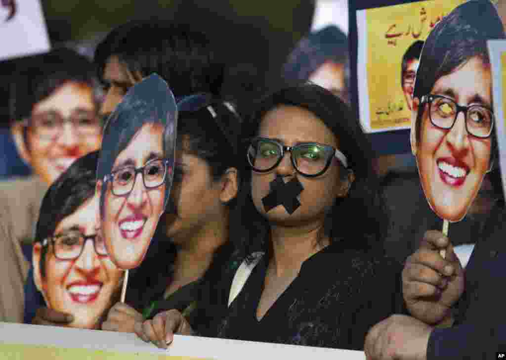 Supporters of prominent women's rights activist Sabeen Mahmud, who was killed by unknown gunmen, hold her pictures during a rally in Islamabad, Pakistan. Gunmen on a motorcycle killed Mahmud last Friday in Pakistan just hours after she held a forum on the country's restive Baluchistan region, home to a long-running insurgency, police said.