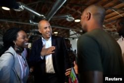 U.S. Senator and Democratic presidential candidate Cory Booker, center, talks to a supporter after speaking at a Gun Violence Prevention roundtable in Los Angeles, Aug. 22, 2019.