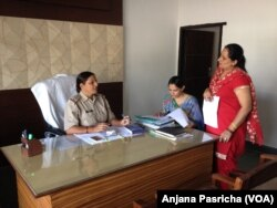 Inspector Umesh Bala gives instructions to her staff at the Women Police Station in Gurgaon, Haryana.