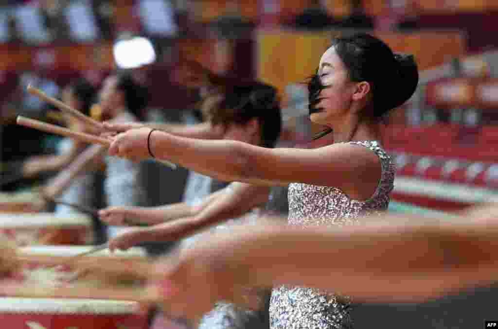 Drummers perform during rehearsals at the Bird's Nest National Stadium ahead of the IAAF Athletics World Championships in Beijing, China.