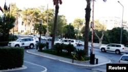2013年10月1日载着国际专家的联合国车队开进大马士革一家旅店.