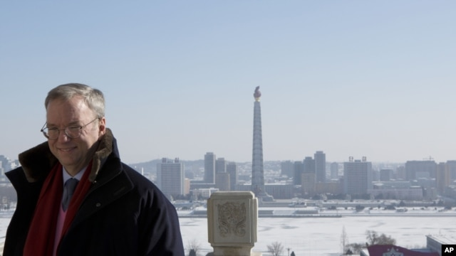 Executive Chairman of Google Eric Schmidt stands on a balcony at the Grand Peoples Study House overlooking Juche Tower in Pyongyang, North Korea, January 9, 2013.