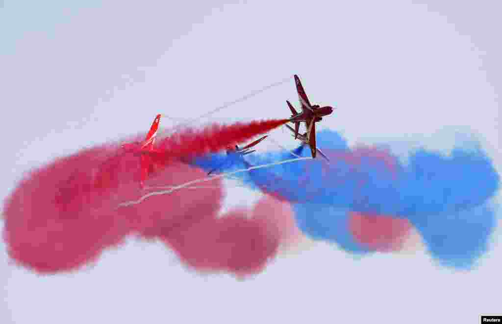 The Red Arrows, the British Royal Air Force Aerobatic Team, perform at the Malta International Airshow 2013 at Malta International Airport, outside Valletta, Malta, Sept. 29, 2013.