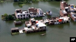Submerged houses are seen in Allahabad, India, Aug. 26, 2016.