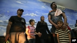 Officials said they rescued 60 asylum seekers after their boat broke down while trying to reach Australia, July 29, 2012.