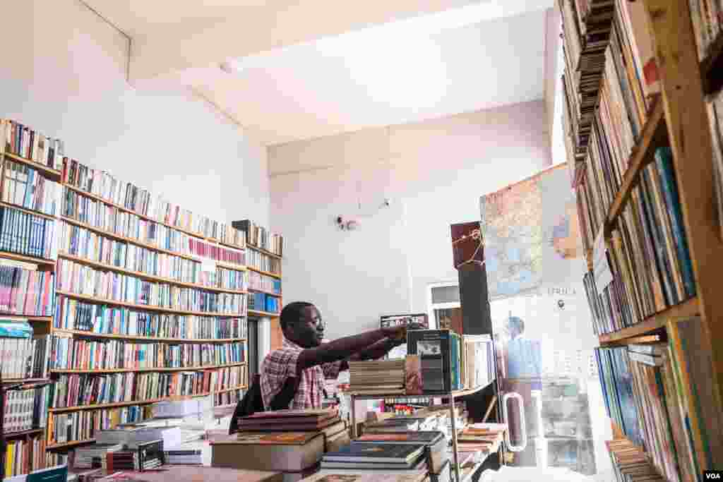 A customer is seen at the Coimbra Bookshop in Bissau, one of the few places to buy books from local authors in the capital, in Bissau, Guinea-Bissau, Dec. 19, 2017. (R. Shyrock/VOA)