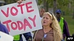 Американские избиратели решают вопросы о зародышах и профсоюзах