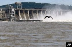 Water flows through Conowingo Dam, a hydroelectric dam spanning the lower Susquehanna River near Conowingo, Md., on Thursday, May 16, 2019. (AP Photo/Steve Ruark)