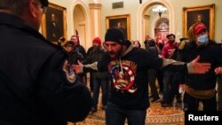 Law enforcement officers push back against supporters of U.S. President Donald Trump attempting to enter U.S. Capitol during a protest against the certification of the 2020 U.S. presidential election results by the U.S. Congress, in Washington, U.S., January 6, 2021. REUTERS/Jim