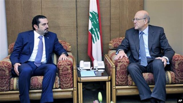 Lebanon's PM-designate Najib Mikati (R) meets with caretaker PM Saad Hariri (L) at the Parliament during consultations to form a new cabinet, Beirut, Jan 27 2011