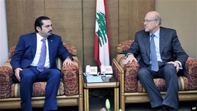 Lebanon's PM-designate Najib Mikati (R) meets with caretaker PM Saad Hariri (L) at the Parliament during consultations to form a new cabinet, Beirut, Jan 27 2011