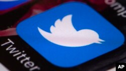 FILE - The Twitter app is seen on a mobile phone in Philadelphia.