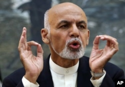 FILE - Afghanistan's President Ashraf Ghani talks during a press conference at presidential palace in Kabul, Afghanistan, Oct. 1, 2015.