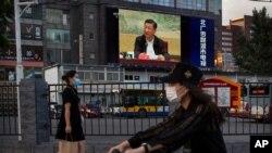지난달 30일 중국 베이징의 전광판에 시진핑 중국 국가주석이 연설하는 모습이 보도되고 있다. (자료사진)