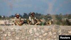 Egyptian soldiers keep guard on the border between Egypt and southern Gaza Strip, July 8, 2013, after armed men launched a series of attacks on security checkpoints in the North Sinai towns of Sheikh Zuweid and El Arish.