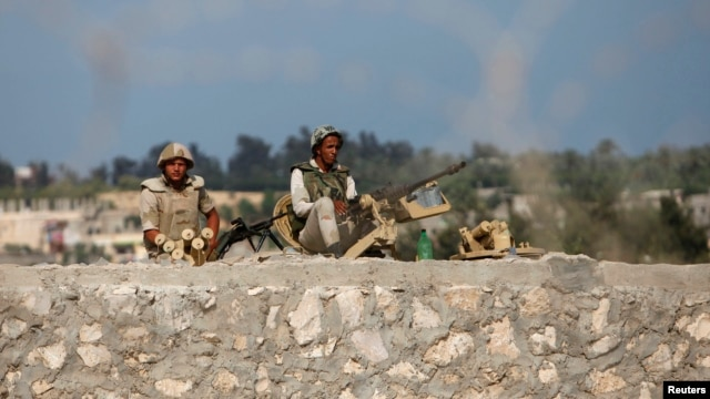Egyptian soldiers keep guard on the border between Egypt and southern Gaza Strip, July 8, 2013.