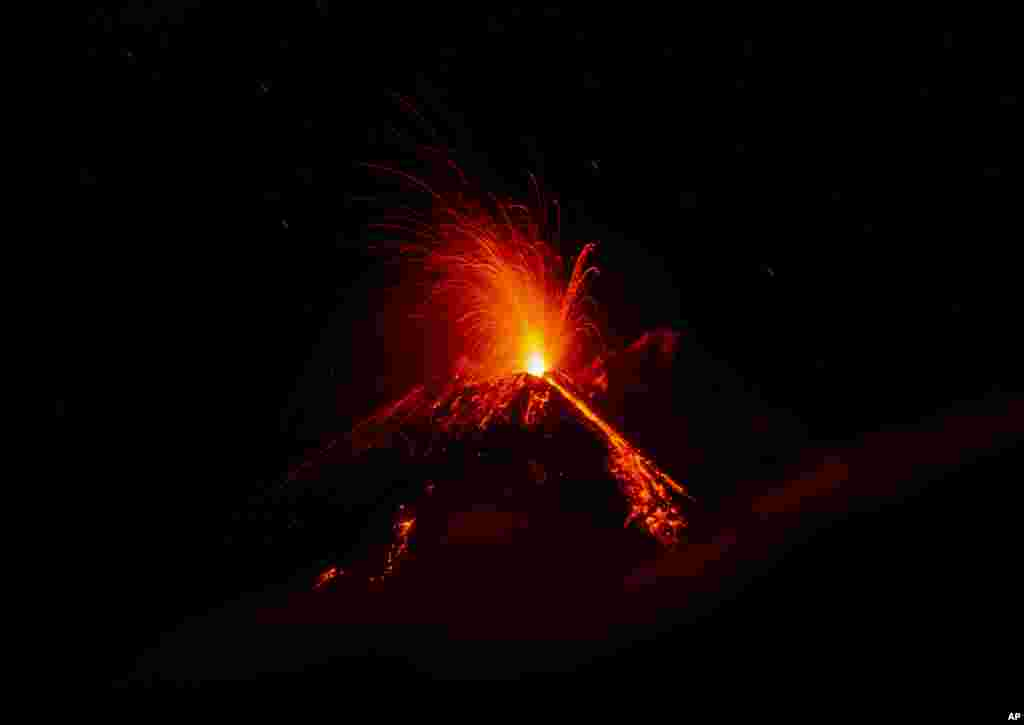 Mount Etna volcano spews lava during an eruption. Dec. 8, 2018. Mount Etna in Sicily has roared back into spectacular volcanic action, sending up plumes of ash and spewing lava.