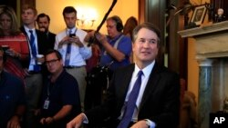 Supreme Court nominee Brett Kavanaugh listens to Sen. Rob Portman, R-Ohio, on Capitol Hill in Washington, during a meeting, July 11, 2018.