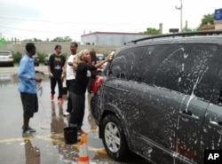 FILE - Somali-Americans in Minnesota participate in a car-wash fundraiser to help Somali drought victims in 2012.