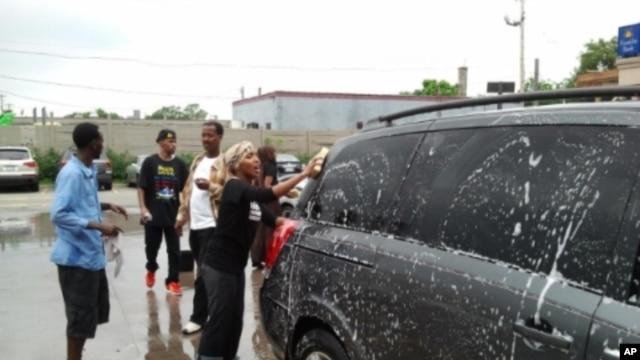 Somali-Americans in Minnesota at a car washing fundraiser to help Somali drought victims.