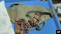 In Mogadishu, AU forces display ammunition left behind by militants.