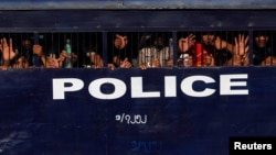 Detained student protesters are seen in a prison vehicle after the violence in Letpadan March 10, 2015. Myanmar police beat students with batons and detained some of them as they broke up a group of about 200 protesters who had been locked in a standoff w